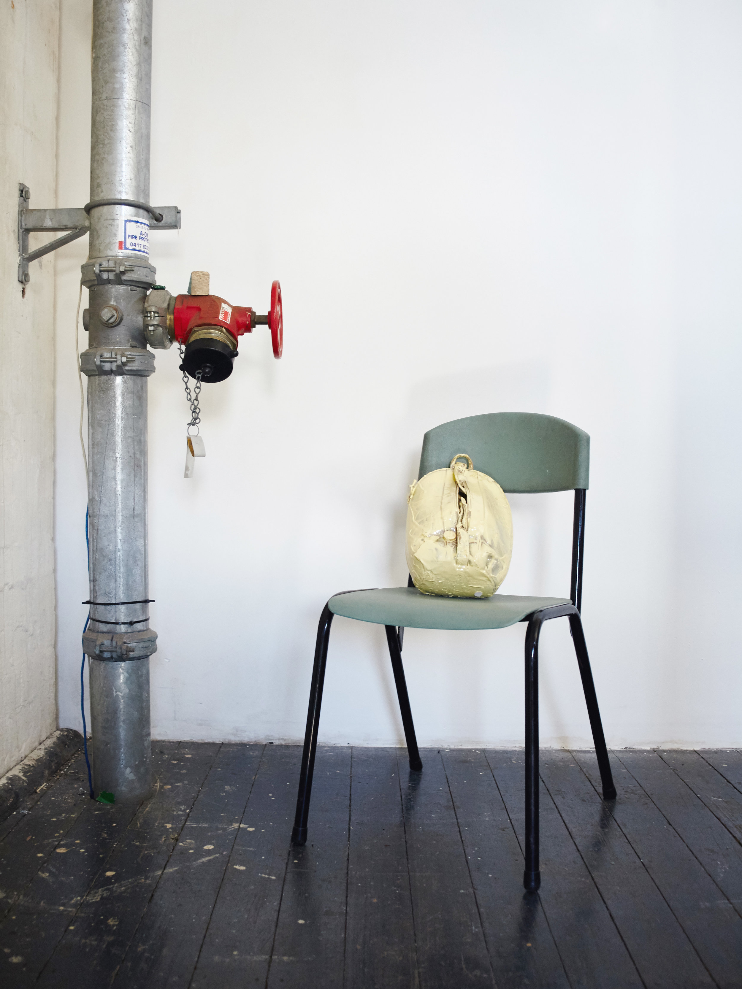 Elif Erkan  Romantic Escapism III – The Bistro Bag  (2014) polyvinyl, acrylic paint, resin, bistro chair, Dimensions Variable Courtesy: Artist / Artun Alaska Arasli, Amsterdam, Netherlands