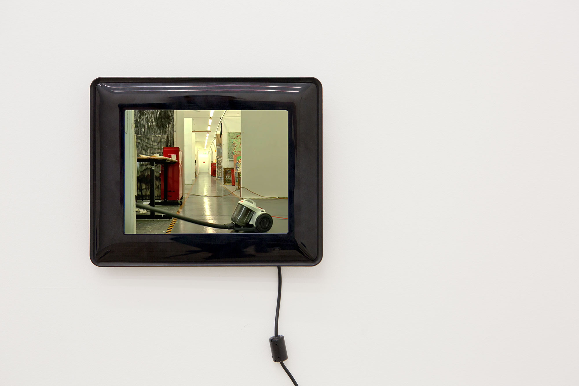 "Stephen Little, ""Vacuum Painting"" (still), 2017, wall mounted video monitor, digital video, 17 minutes, 3 seconds, edition 1/5, Courtesy of Kronenberg Wright Artist Projects, Sydney"