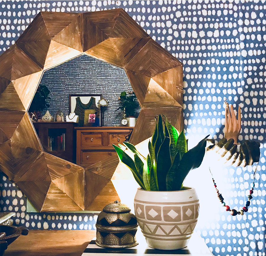 It was important to stay on point with the use of shapes, so throughout the room there are triangular shapes to add more edge to the many many irregular 'dots'.