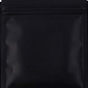 You can buy black ziplock bags online, some are even smell proof!