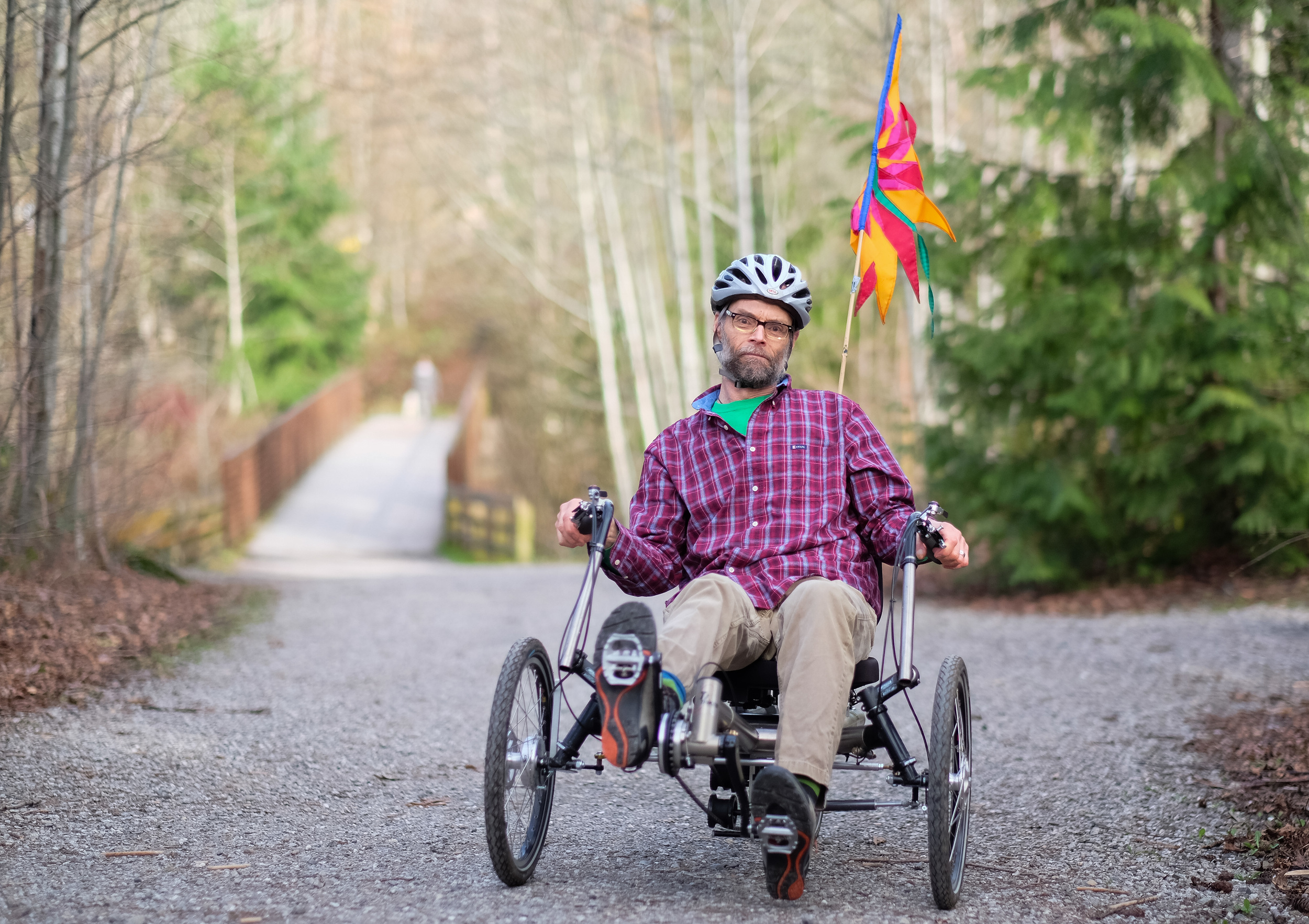 Rick Hermann, 65, poses for a portrait on his recumbent bicycle. Hermann, who has Parkinson's disease, was having increasing difficulty riding his bike until he found recumbent bikes, which help alleviate the stress on the body by placing the seat lower and further back in a reclined position on the bike. For Klipsun Magazine