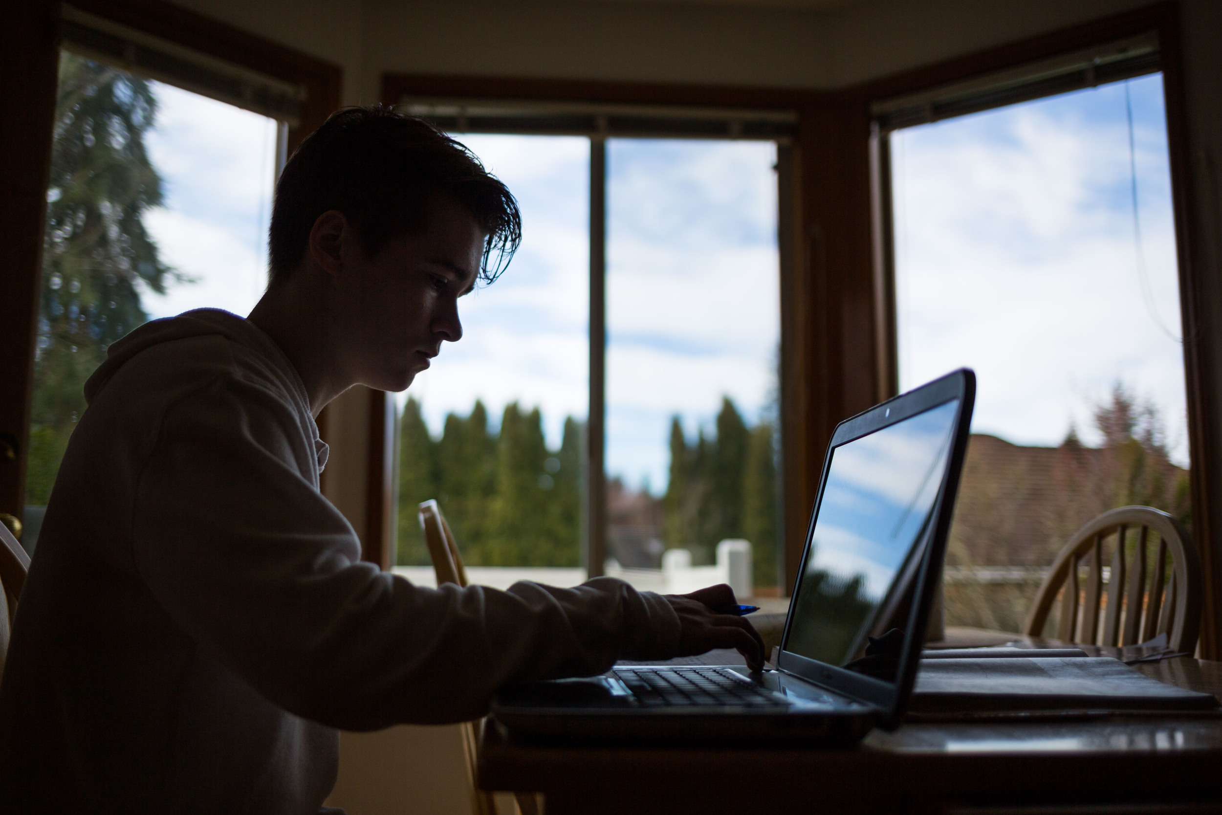 BRADEN HANSEN USES HIS COMPUTER FOR HOMEWORK AT HIS HOME IN MUKILTEO. TO HELP DEAL WITH HIS DISORDER, HANSEN ADHERES TO SOME RECOMMENDATIONS TO HELP REDUCE FATIGUE LIKE AVOIDING ALCOHOL AND NICOTINE. For Klipsun Magazine