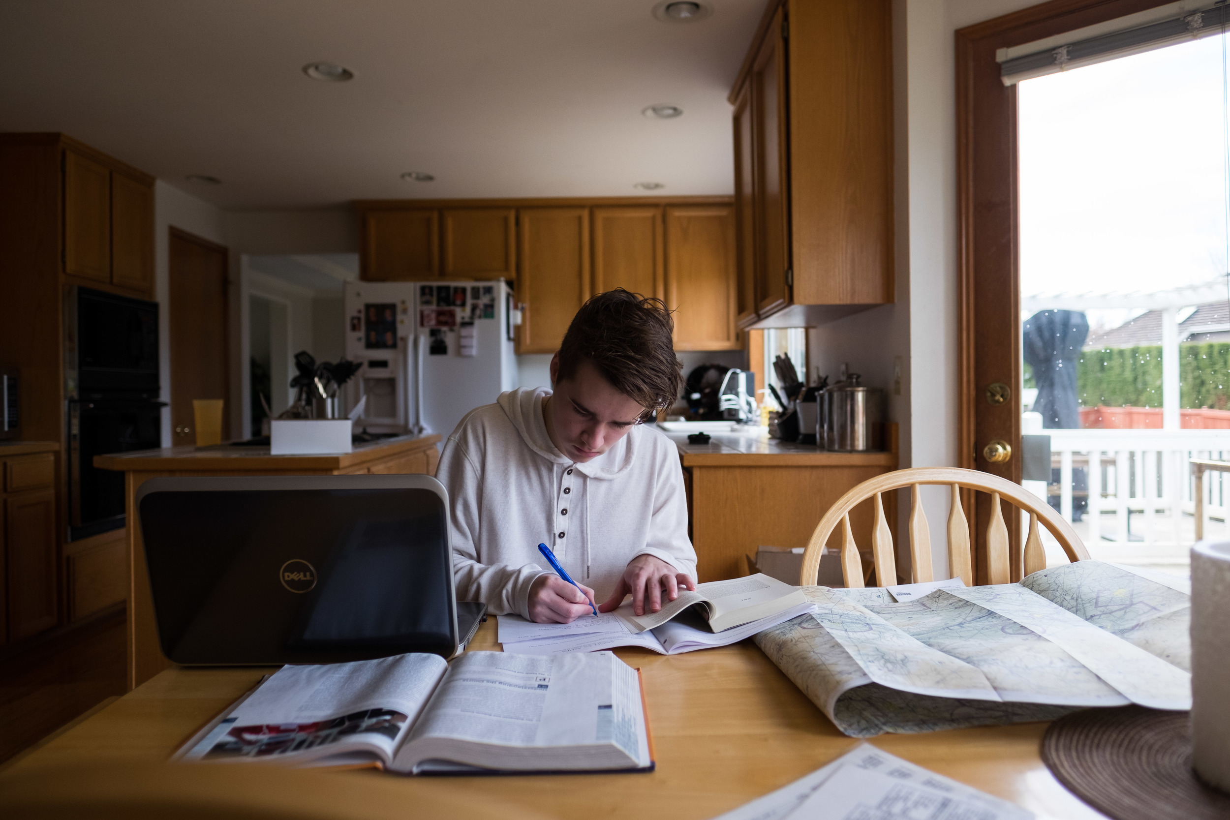 Braden Hansen, a high school senior, works on his homework at his house in Mukilteo, Wash.. Hansen, 18, was diagnosed with narcolepsy last year, a rare sleep disorder for teenagers. For Klipsun Magazine