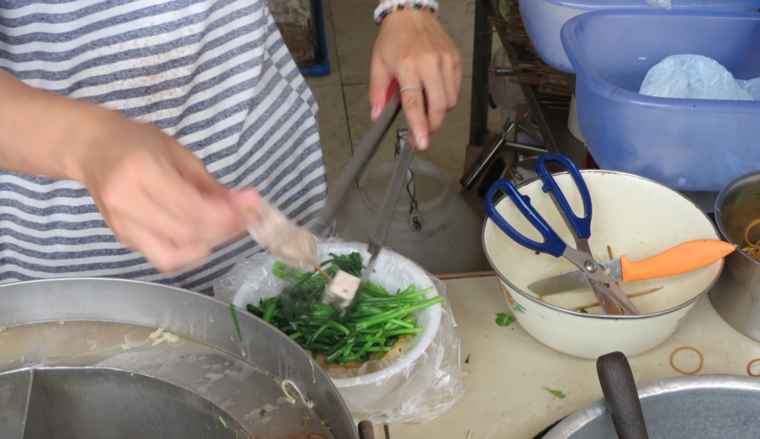 Pick your own ingredients for noodle soup in a guangzhou alley