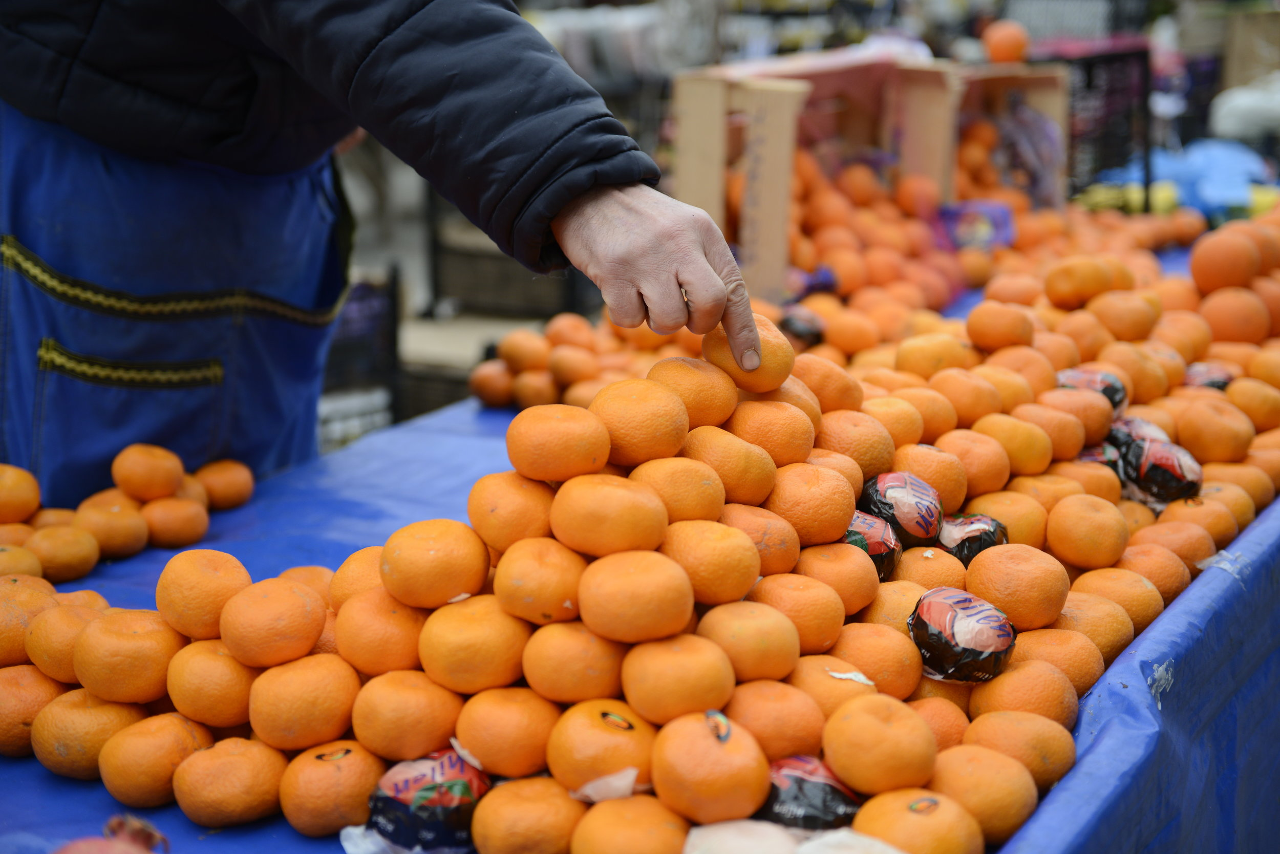 produce vendors arrive early to prepare perfect displays