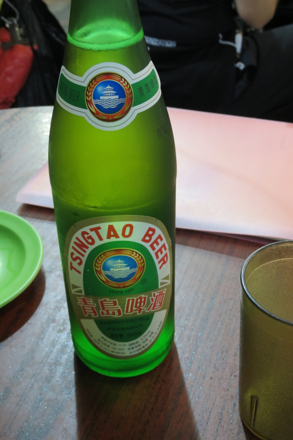 A cold Tsingtao beer complements the fish dinner at Hong Kong's Temple Street Night Market