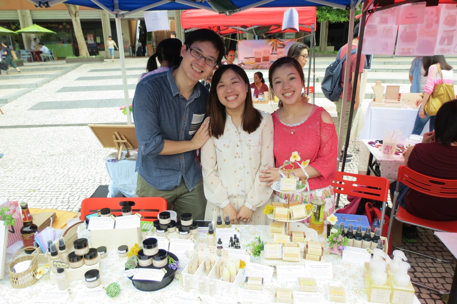 Shirley, center, with her husband and her sister, has created the Kiddy Shirley brand of Hong Kong handmade soaps