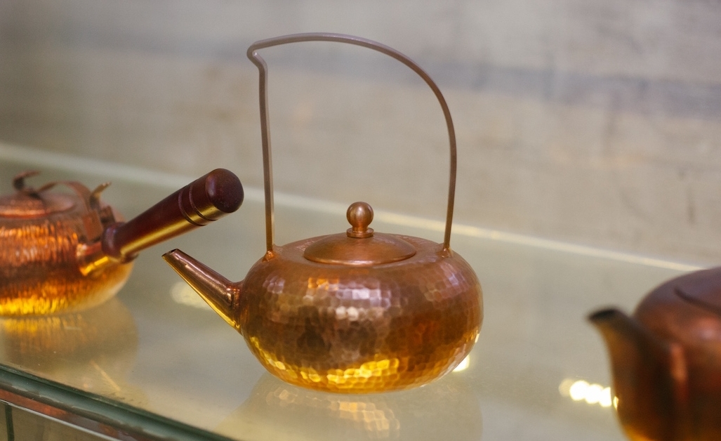 Tiny, hand-forged copper tea pot in the the family-owned Baohui Copper Workshop in Old Guangzhou