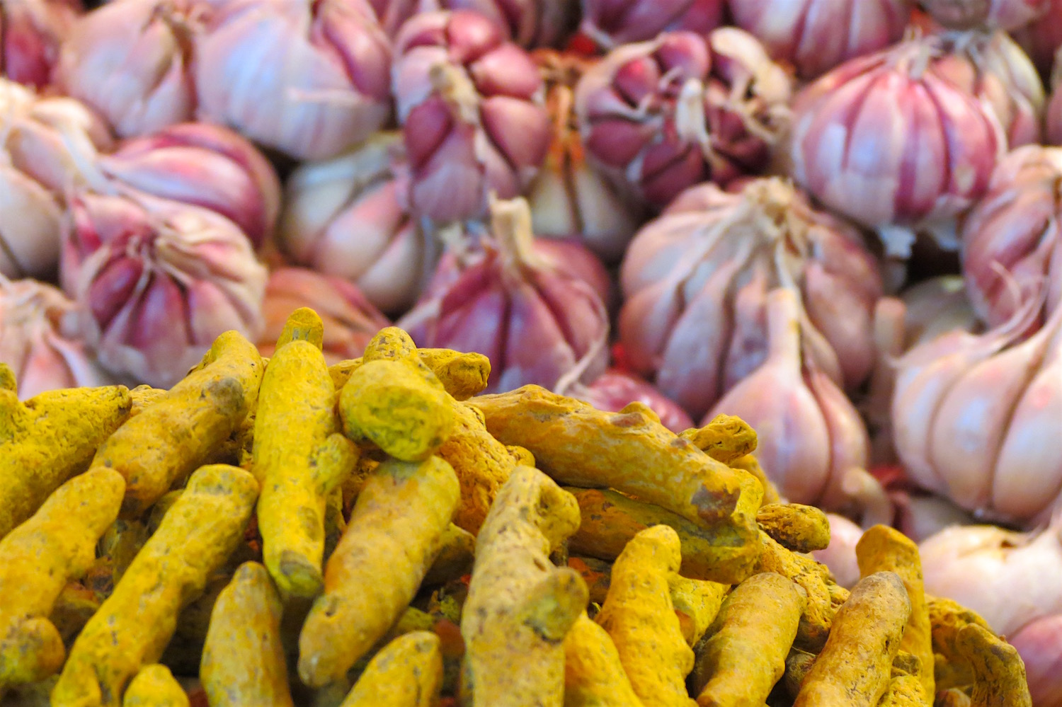 Rosy pink garlic and vivid yellow turmeric in Casablanca's Habous Market