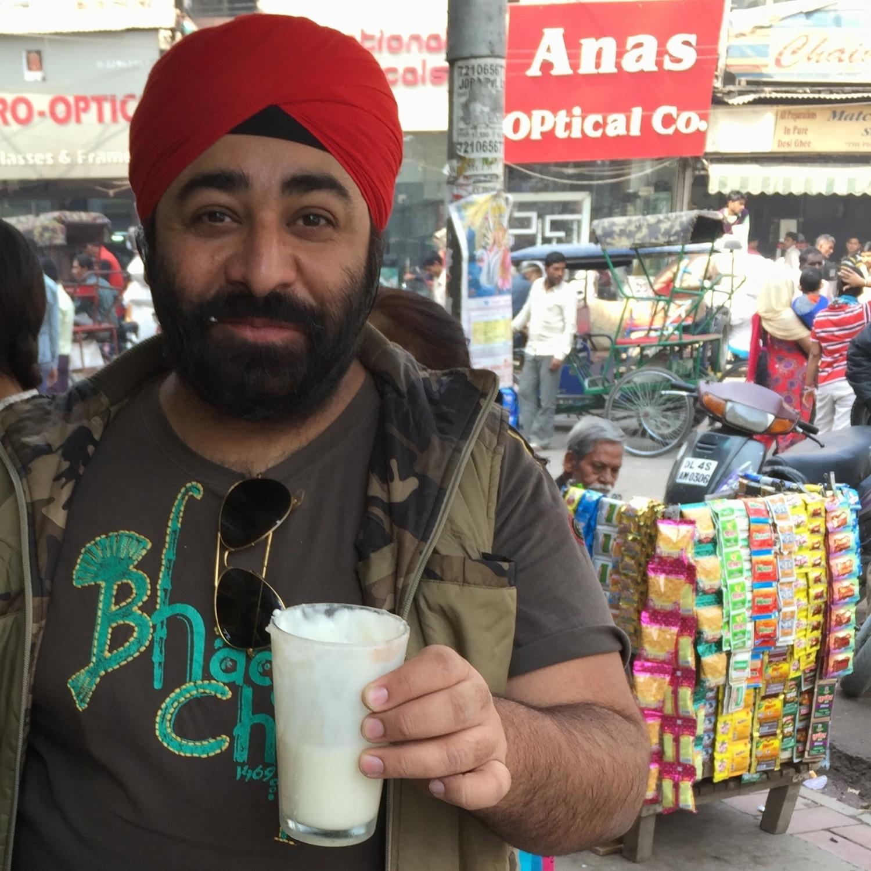 Mister Tikku samples a sweet lassi in Delhi's Chandni Chowk market