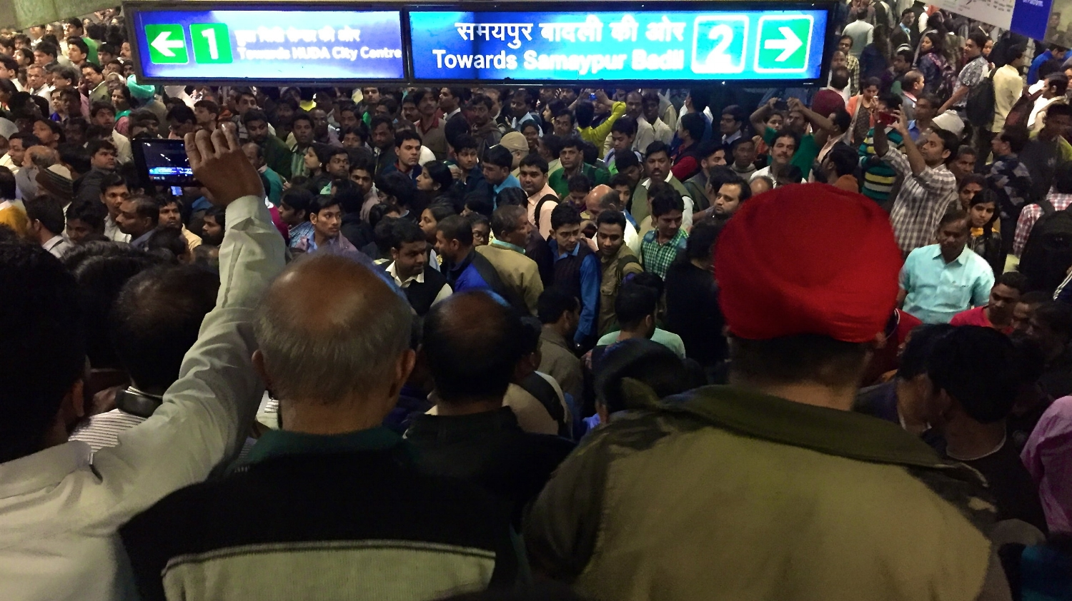 Mister Tikku's signature red turban is a beacon in the Connaught Place metro station