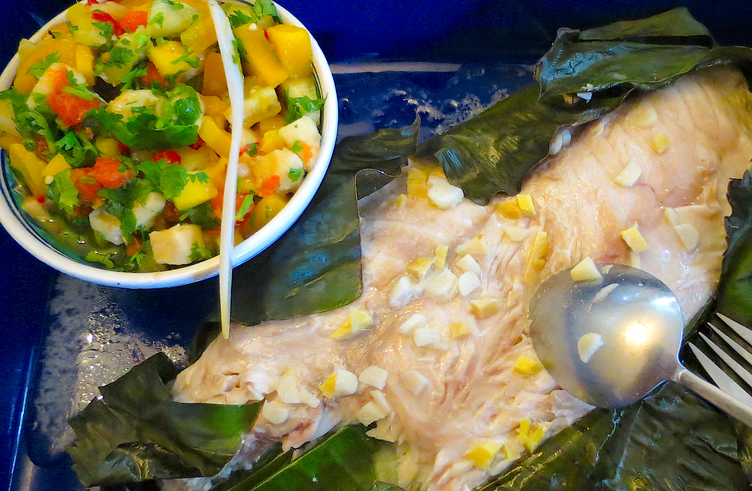 Red snapper in banana leaf with mango chili salsa