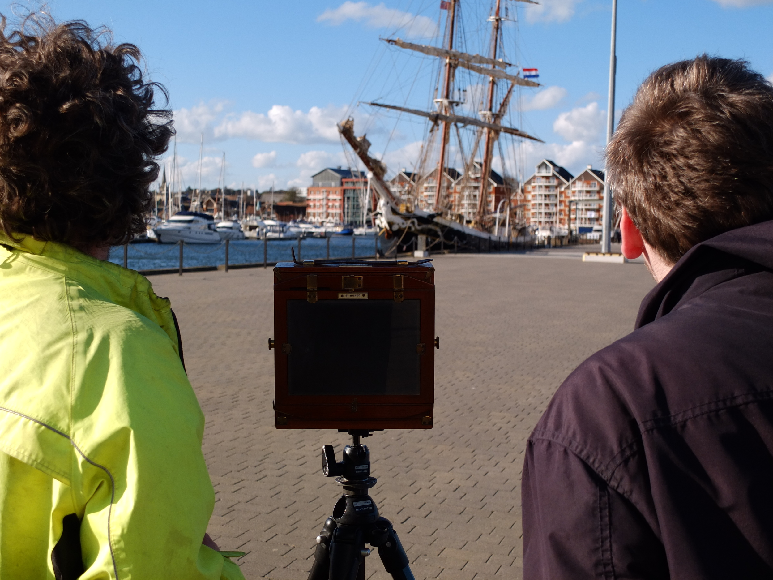 Tim and one of the star participants, Joel, taking a photo of a square rig on the marina