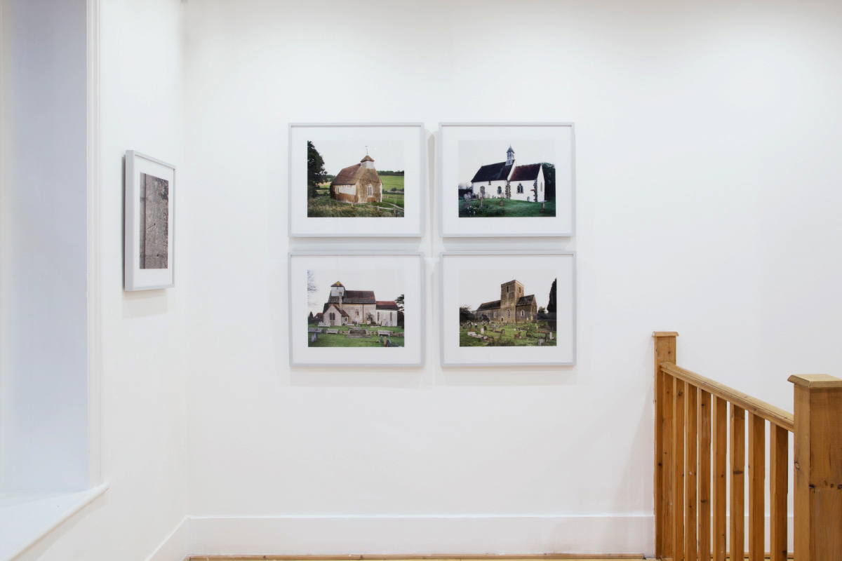 Lie of the Land   installation shot: images form the series  Churches  by James Dobson