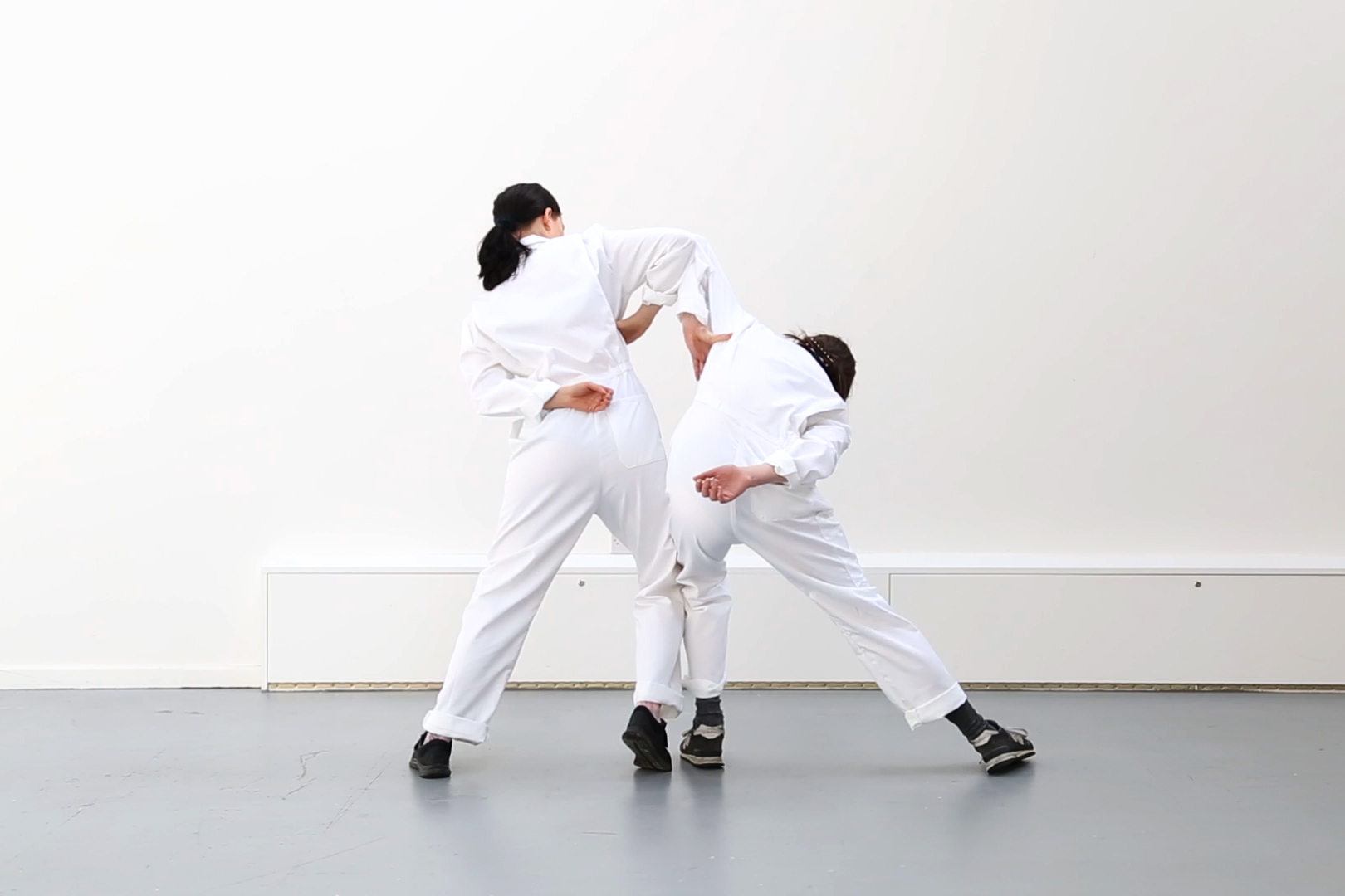 'Circuit Training  (exercises in self-doubt)'  Stills from rehearsal, 2018.  The body as material and body as apparatus. 'Circuit Training' is a live choreographic work, which focuses on fragmented (parts of the body) via delineated exercise-style segments:   score: [...] The body; (knee joints, elbow levers, hip-bones)    — fractious fragments    The circuit; (winding, weaving, coiling) — suturing them back together   In conversation with  To be confirmed: exercises in self-doubt  — a collection of three essays, ('Morphology of the Hit', 'Circuit Training' & 'Body Language') written by the artist and published on the occasion of The Royal College of Art Degree Show, 2018.