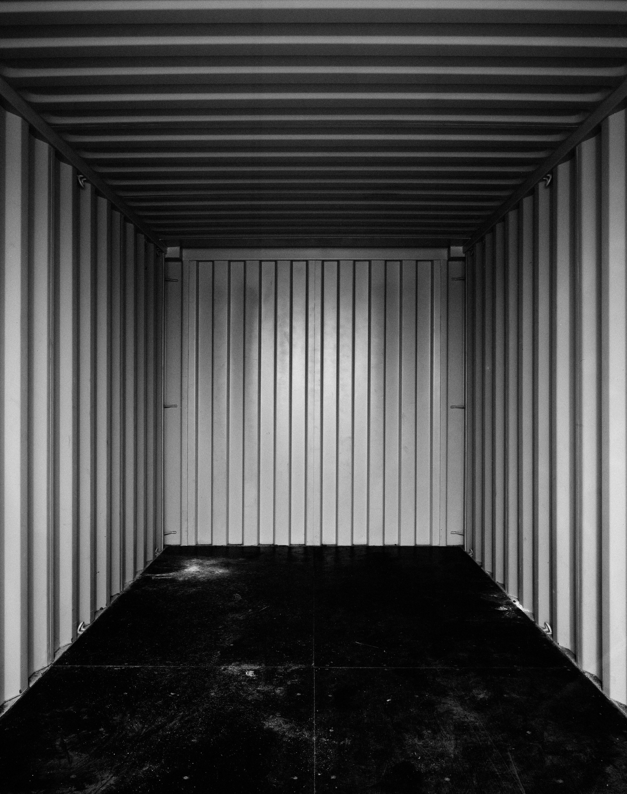 Drones are controlled from storage containers similar to this one with the dimensions being 8x8x20 ft. This puts into question whether these spaces could be considered a battlezone as the pilots operate in those areas. This is made apparent as PTSD is not only achievable in these conditions, but some claim there is a higher percentage of this happening. The distance is important as the operators control the weapons from a risk-free zone, spurring some to call it a type of 'post-heroic' warfare.