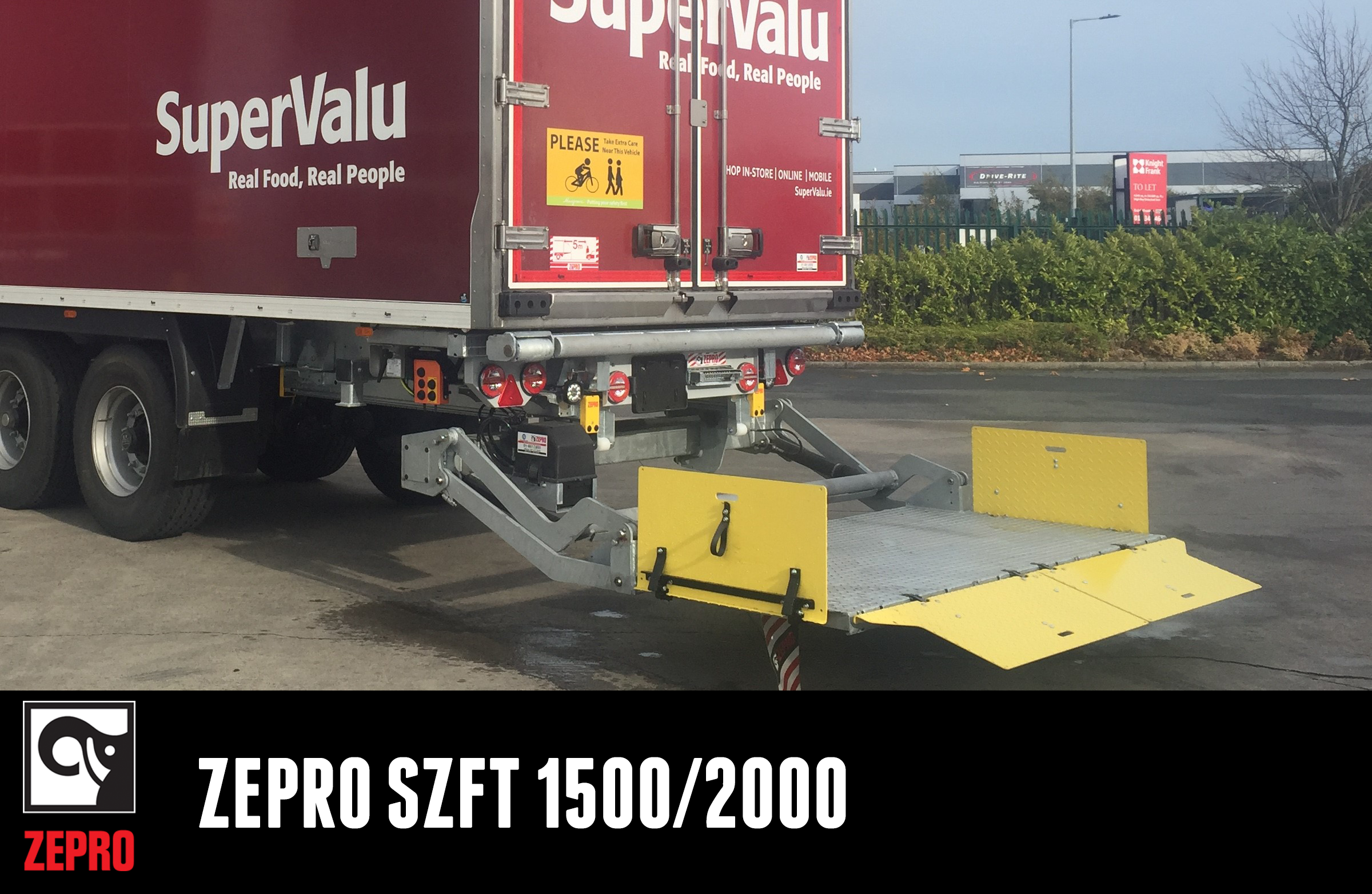 A medium/heavy duty slider lift with a steel platform with folding ramps. Suitable for trucks or semi-trailers.