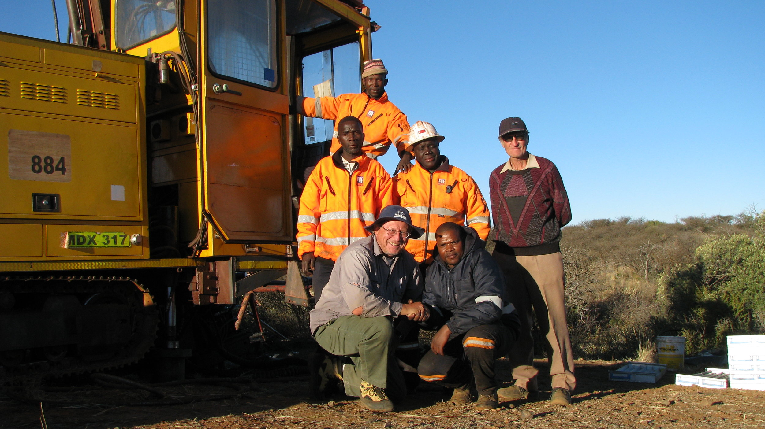 Prof Wlady Altermann (University of Pretoria) and farm owner Oom Peet with the Master Drilling team.