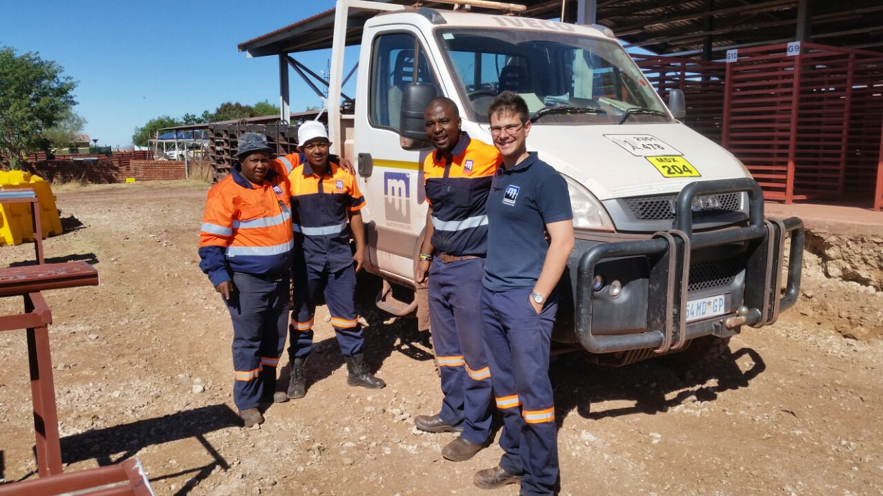 The Master Drilling Quality Assurance team in front of Master Drilling's customszed Iveco core carrier.  From the left: Thuso Mongale, Franklin Miles, Mlamleli Chopela, Francois Stassen.
