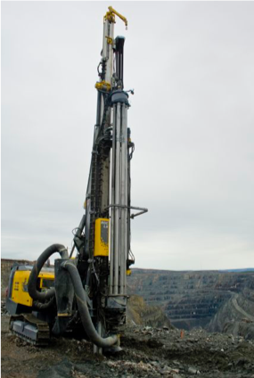 Presplit drill rig with mast mounted carousel.