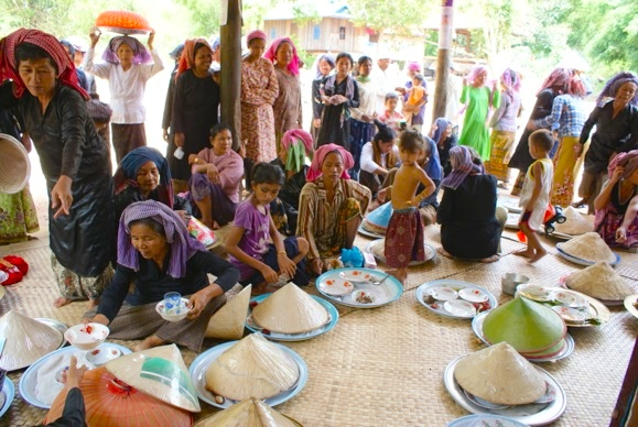 Women prepare food for Friday prayers in O Russei village in Kampong Chhnang