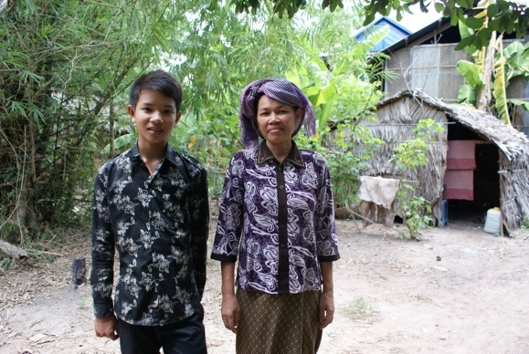 High school student with his mother, O Russei village, Kampong Chhnang province