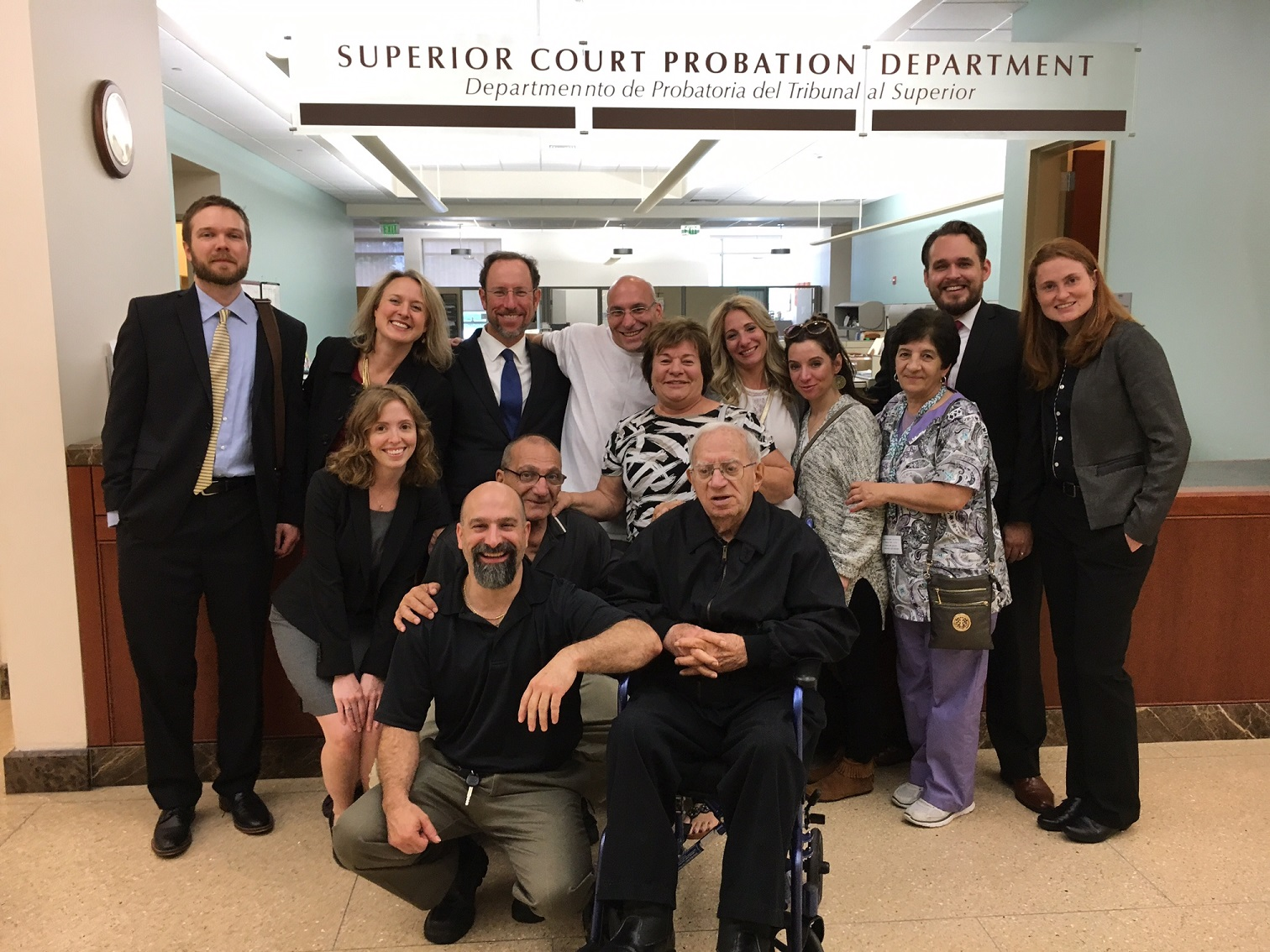 Pictured in addition to Mr. Cosenza's family are (back row, left to right): Attorney Malm, Attorney Kavanaugh, Attorney Wood, Attorney Gant, Attorney Eva Jellison, Attorney Natalie Rice (second row).