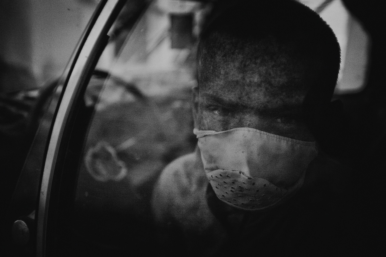 POPCAP_2015_Winner_1280px_RGB_24ok.Yacin wears a mask over the lower part of his face, while waiting for his father in the car. Yacin no longer goes to school because of his condition.jpg