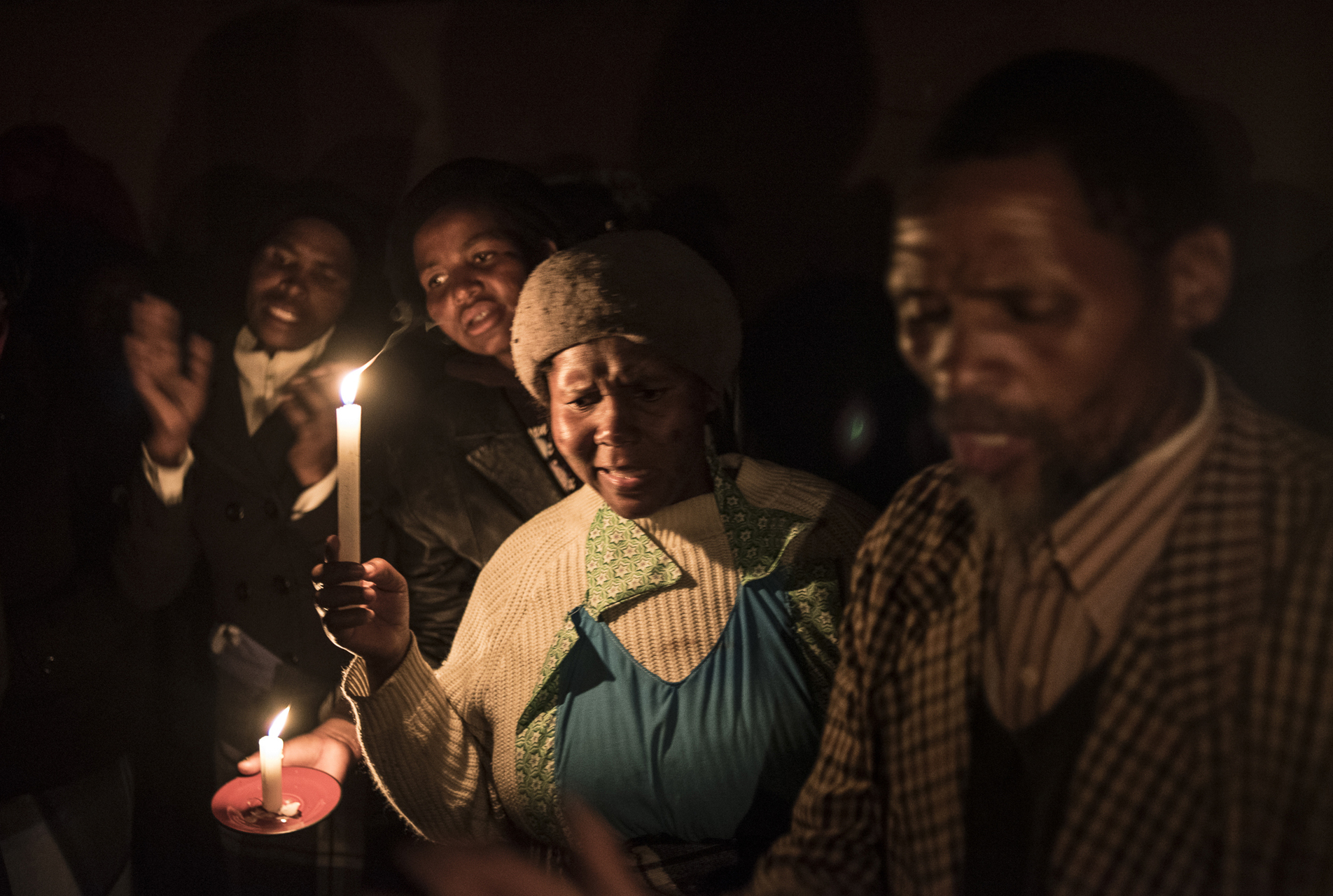 Paul Botes. Mourners sing at the funeral of Sandisa Zimbambele (22), the daughter of Thobisile and Nokuthula Zimbambele, poisoned herself. Her mother had taken a job at Lonmin after her husband had been killed on August 12 2012. From  Marikana - The Aftermath,  2013 – on-going