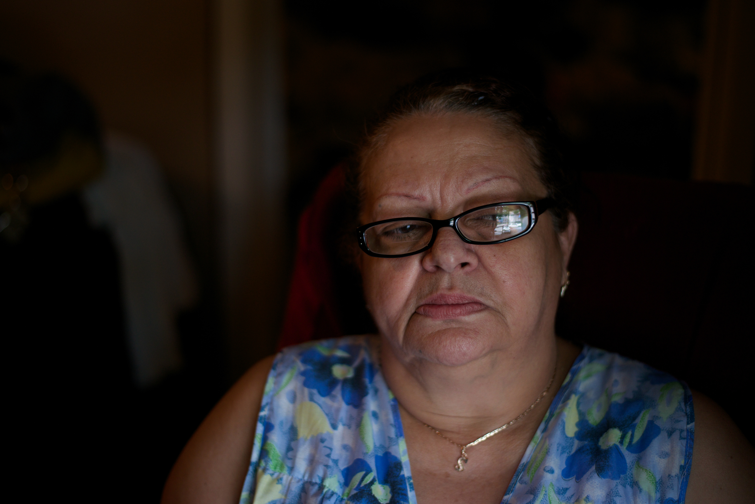 Blanca Sierra, the mother of Denis Reyes, poses for a portrait by her living-room window in her Bronx apartment on May 28, 2015. Her son died in police custody on May 14, 2015.