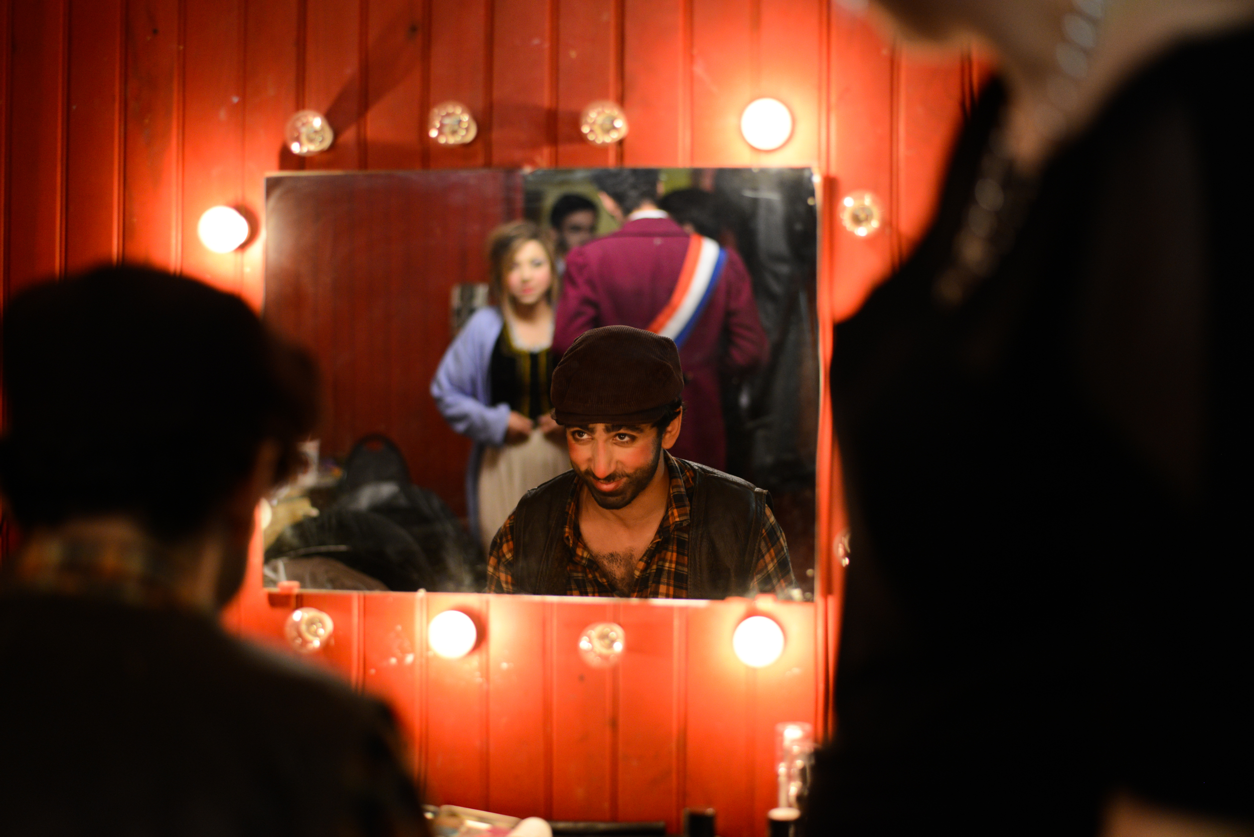Armand Satchian, a French student playing in a college musical, checks his makeup before taking the stage at Déjazet theater in Paris on April 10, 2014.
