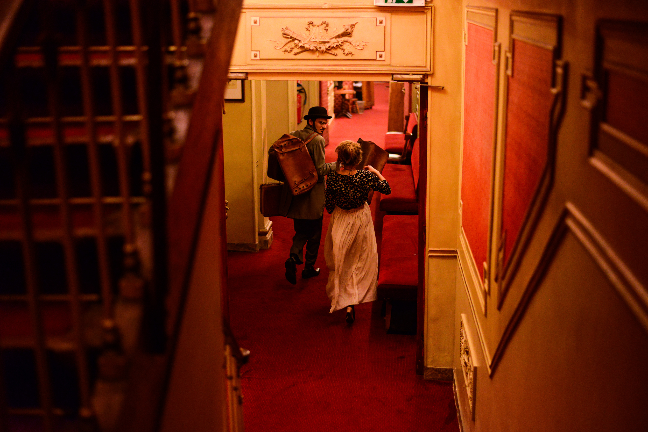 Actress Eva Le Saux Madézo, right, and actor Louis Choukroun, rush through a corridor to the next scene of a musical in which they play at Déjazet theater in Paris on April 10, 2014.