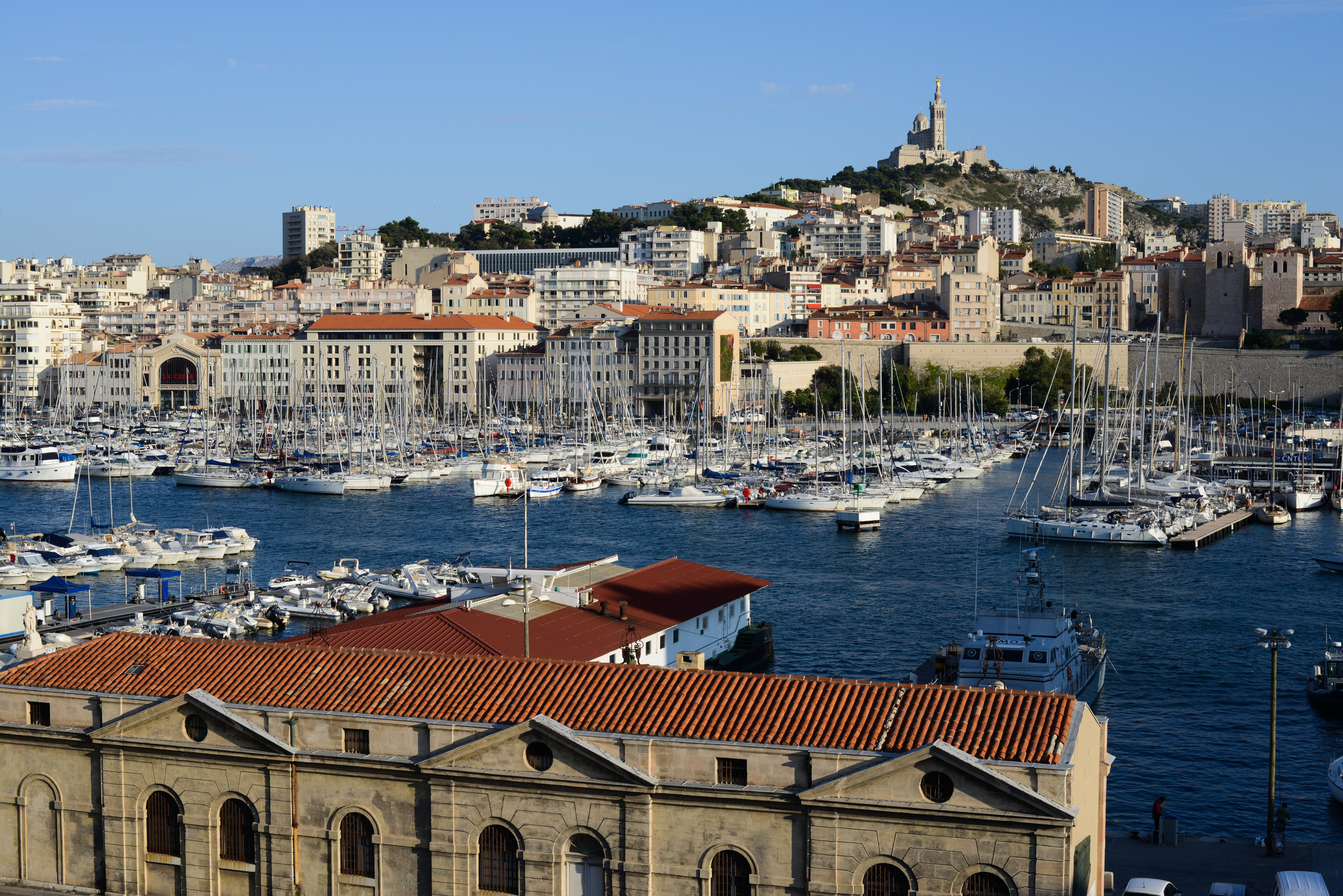 The old port of Marseille, France, with Notre-Dame de la Garde basilica in the background, on August 20, 2014.
