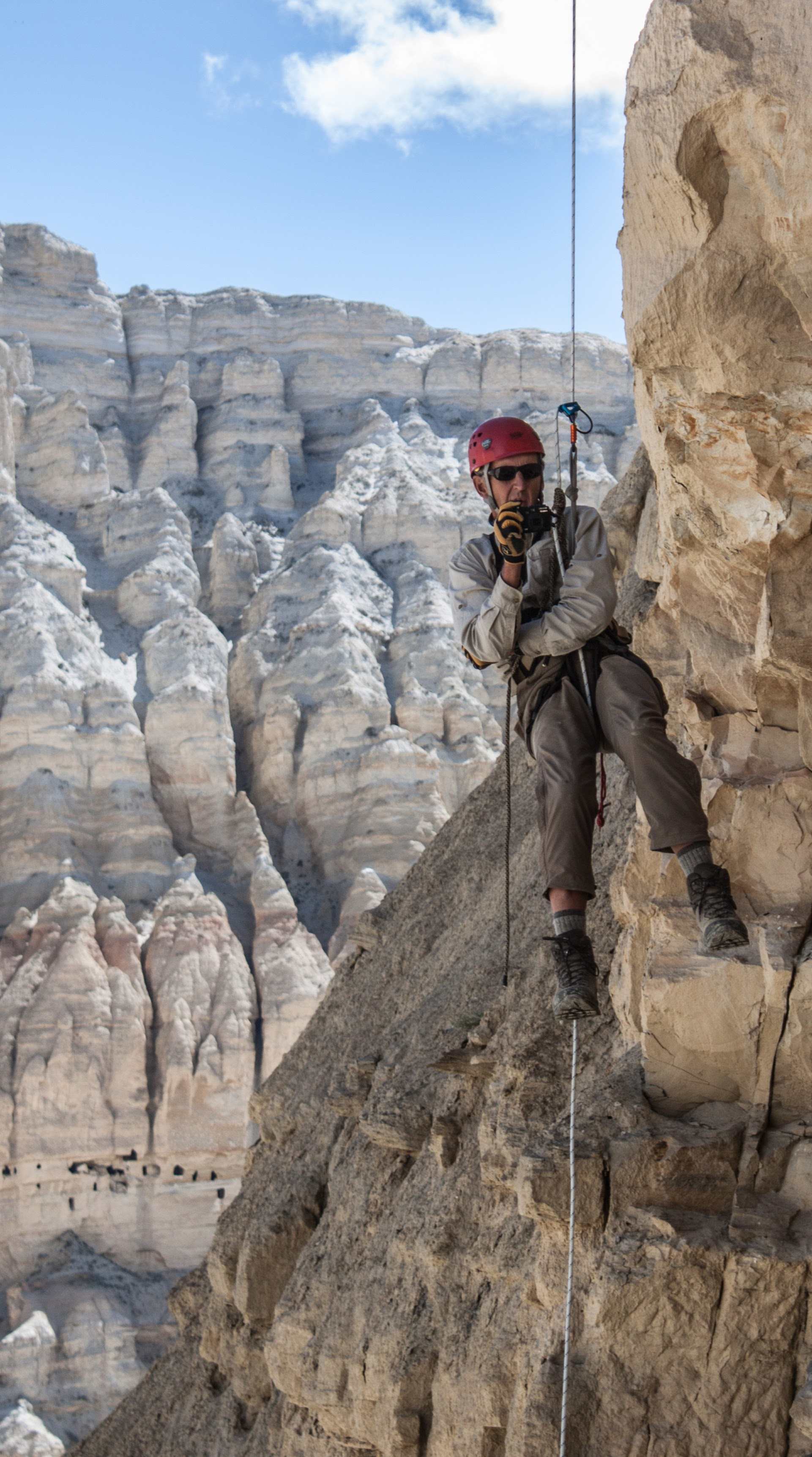 Rappelling 600 feet  in Nepal to reach caves occupied by humans centuries ago