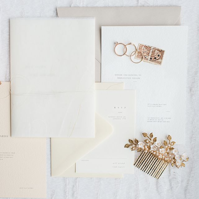 A minimalist approach is always a good idea for a #curated look for wedding invitations. Here I incorporated hand sketched #luneria twigs with classic serif typography and an avant guard layout. ——————— I love a good sneak peek week when @laurakellyweddings is at the helm ✨ a few detail shots from our #betweentheshadowandthesoul concept shoot last week in #mtl  design and styling @toast.events / photography @laurakellyweddings / florals @wearepollennation / invitations @lafaberewedding / crown & earrings @sarahwalshbridal / dress @madewithlovebridal from @revellebridal / hair and makeup @shannondoylebeauty / rings @shopjvstudios / decor @makinitlovely / / cake @cake_whisperer / venue and furniture @joesprophouse / model @angiesmodels @leachess