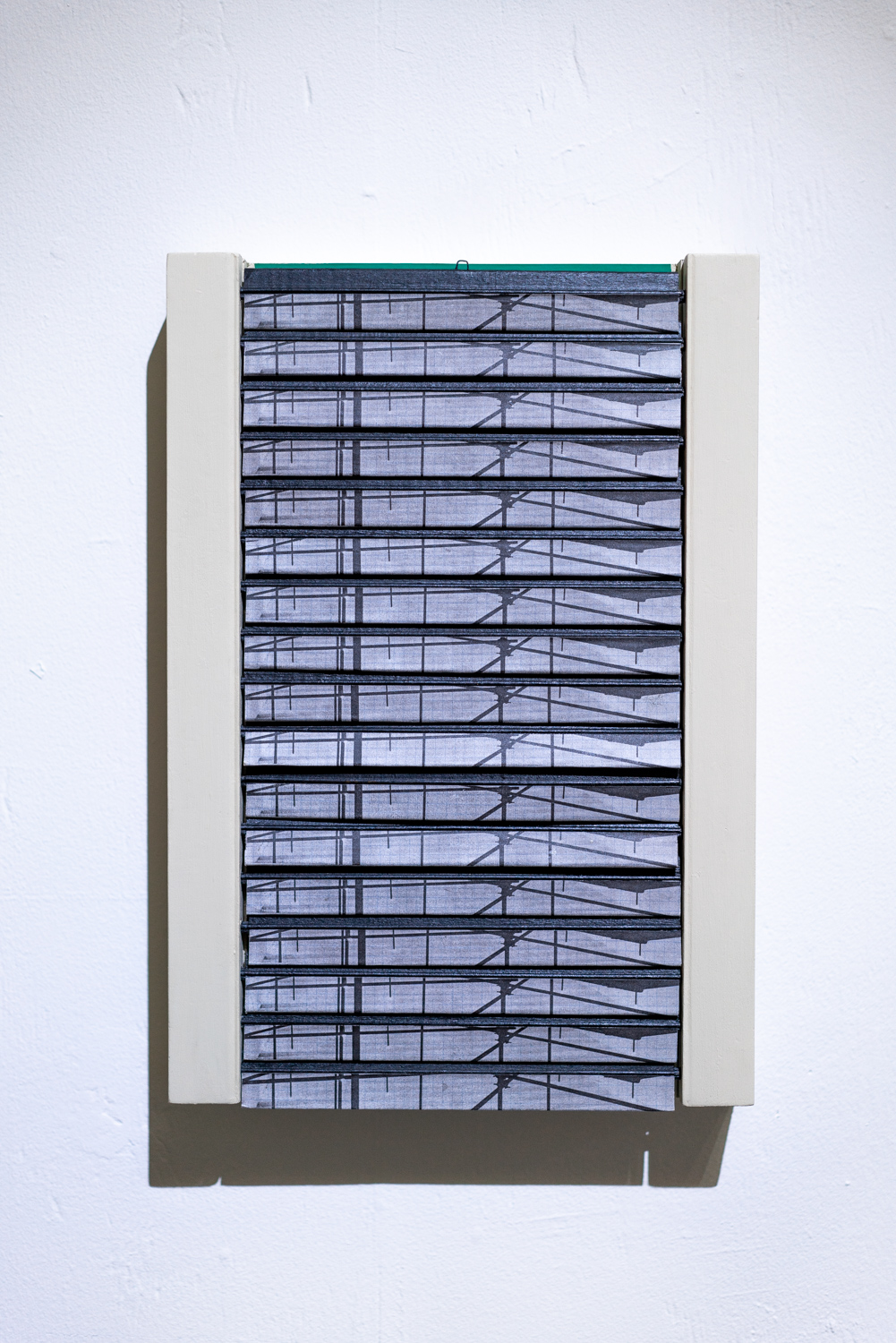 wild and wilderness, 2018    shutters, Domos magazine, milkpaint, electrical tape