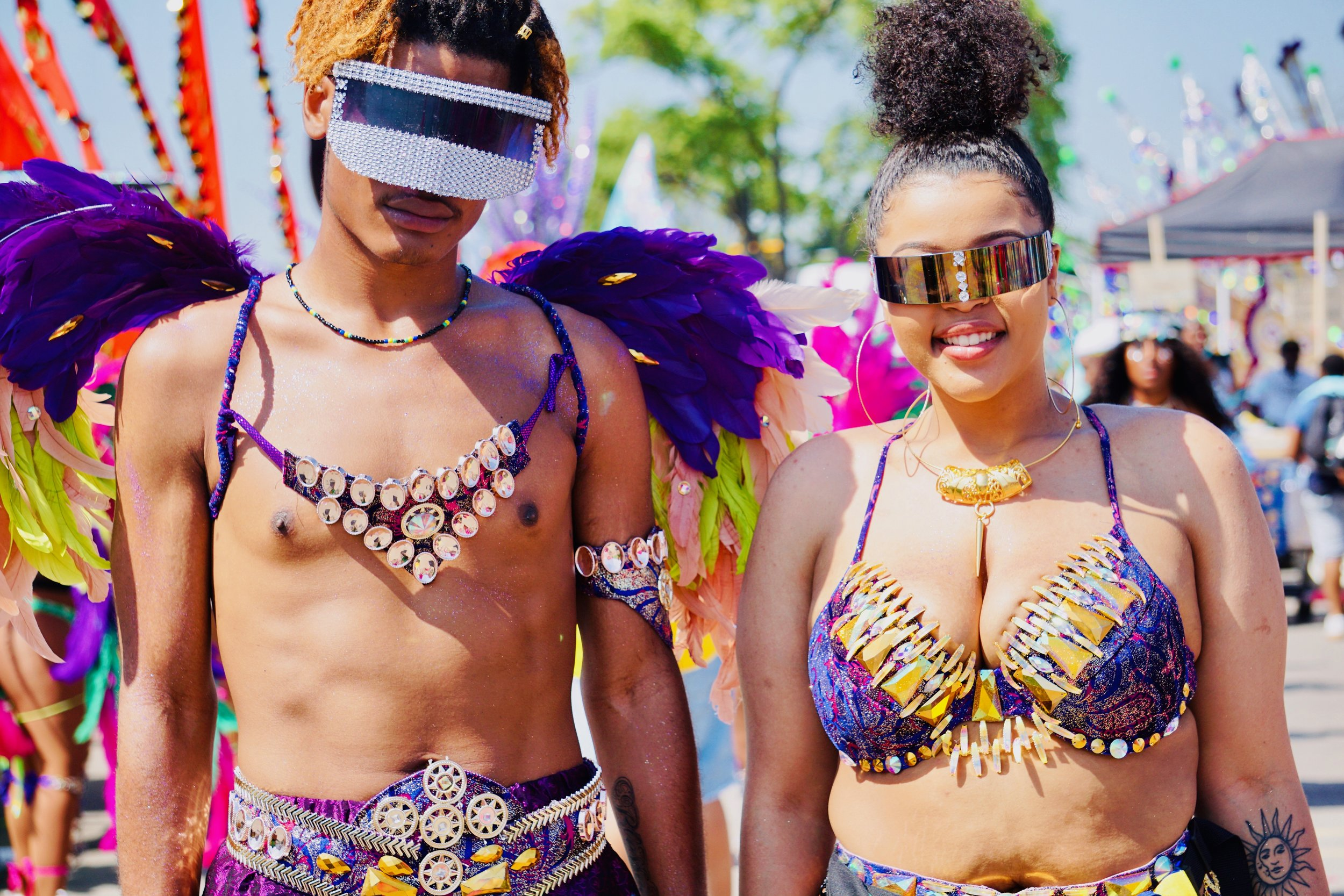 July 3, 2019 (Toronto, Ontario, Canada), Masqueraders enjoying Caribana festivities after participating in the Grande Parade.