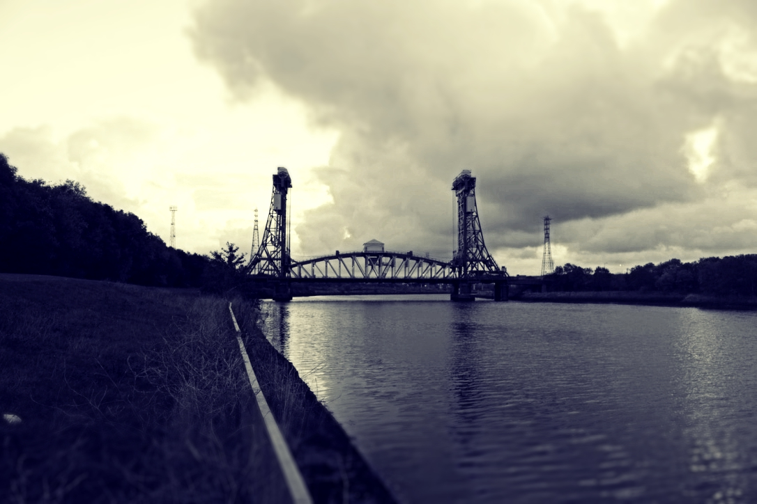 A cloud of memories growing over the Newport Bridge - deep, silent songs from the past
