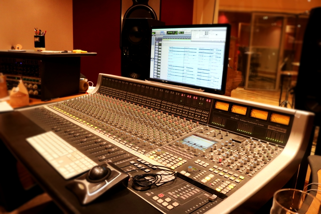 The allure of a mixing console and a pro-tools session