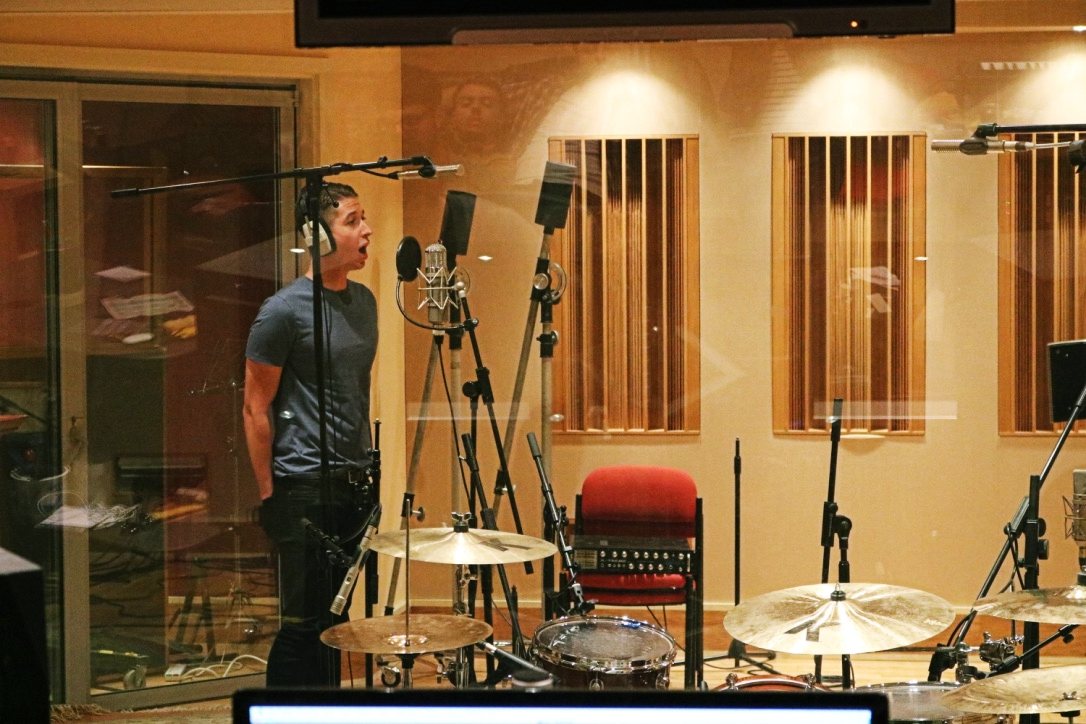 Liam Rowden recording the vocals