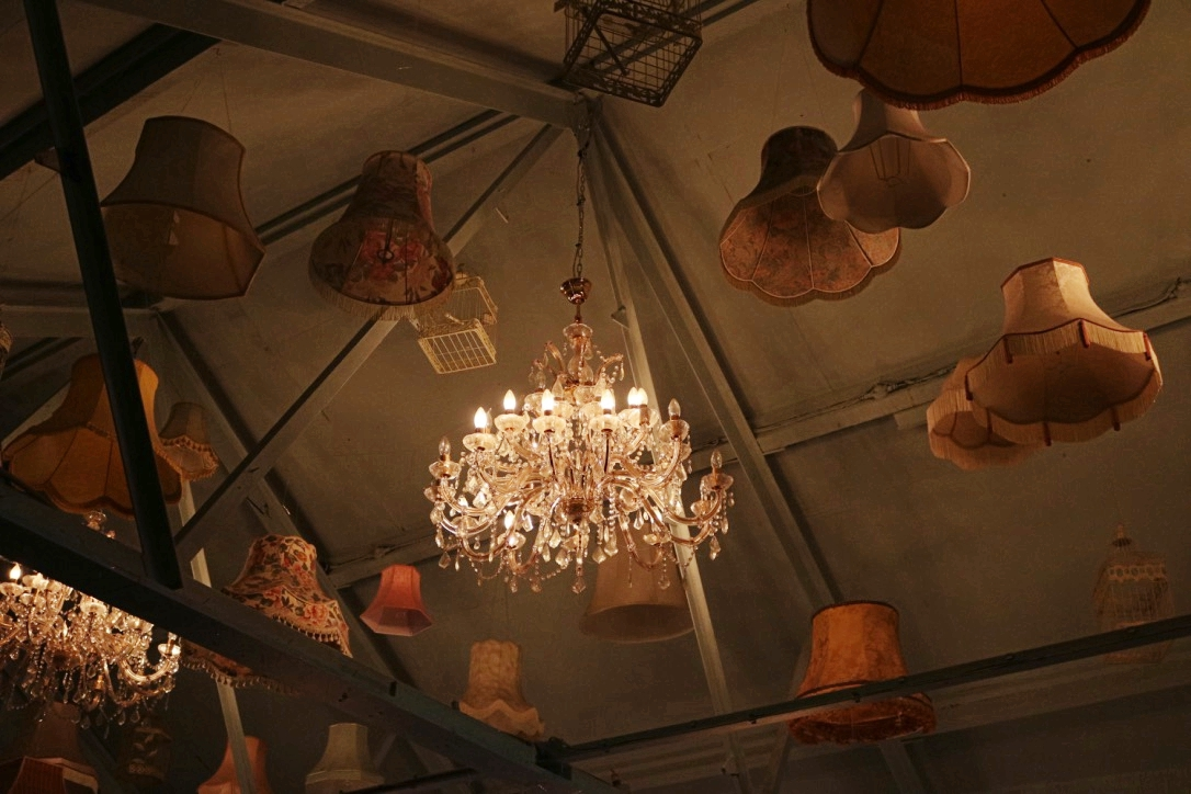 Inside the adjoining bar: chandeliers and floating lampshades