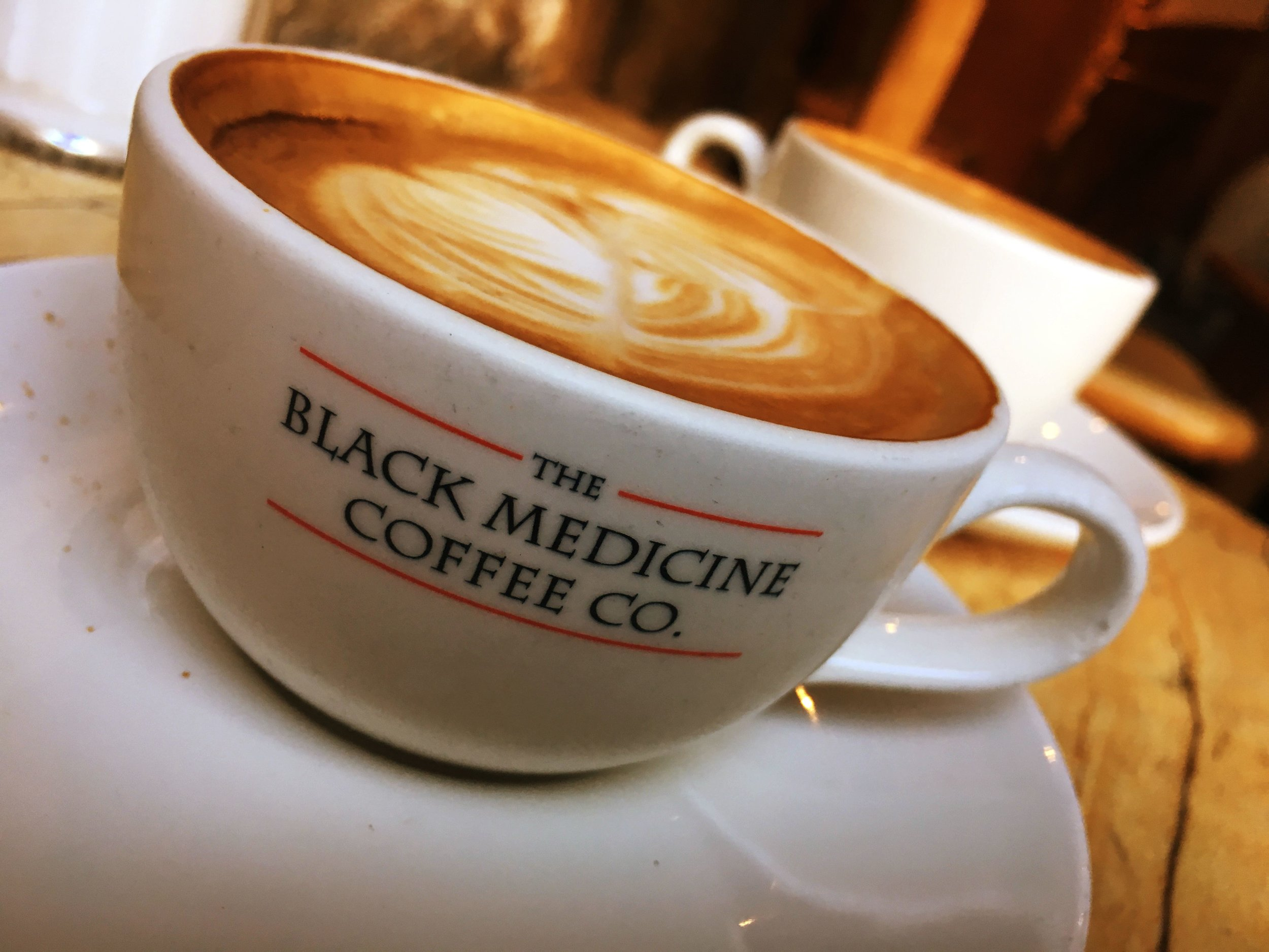 The Black Medicine Coffee Co.  : Rustic wooden interior, countless tables in all shapes and sizes, arty vibe and great coffee