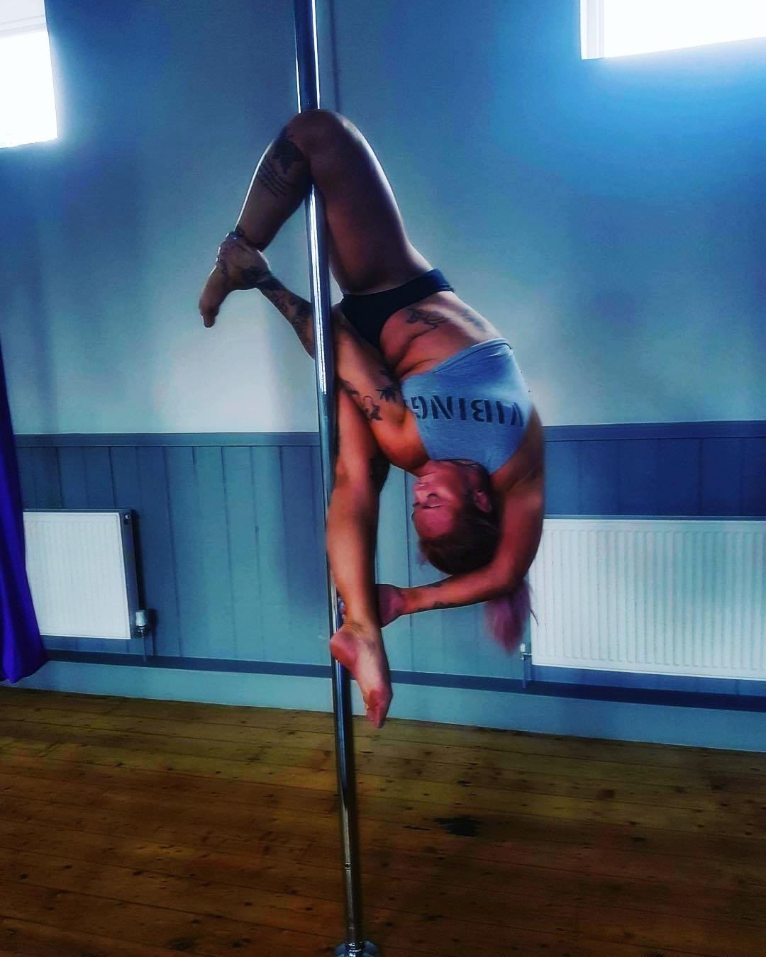 Sarah Guthrie preforming an advanced pole move - photo courtesy of Sarah