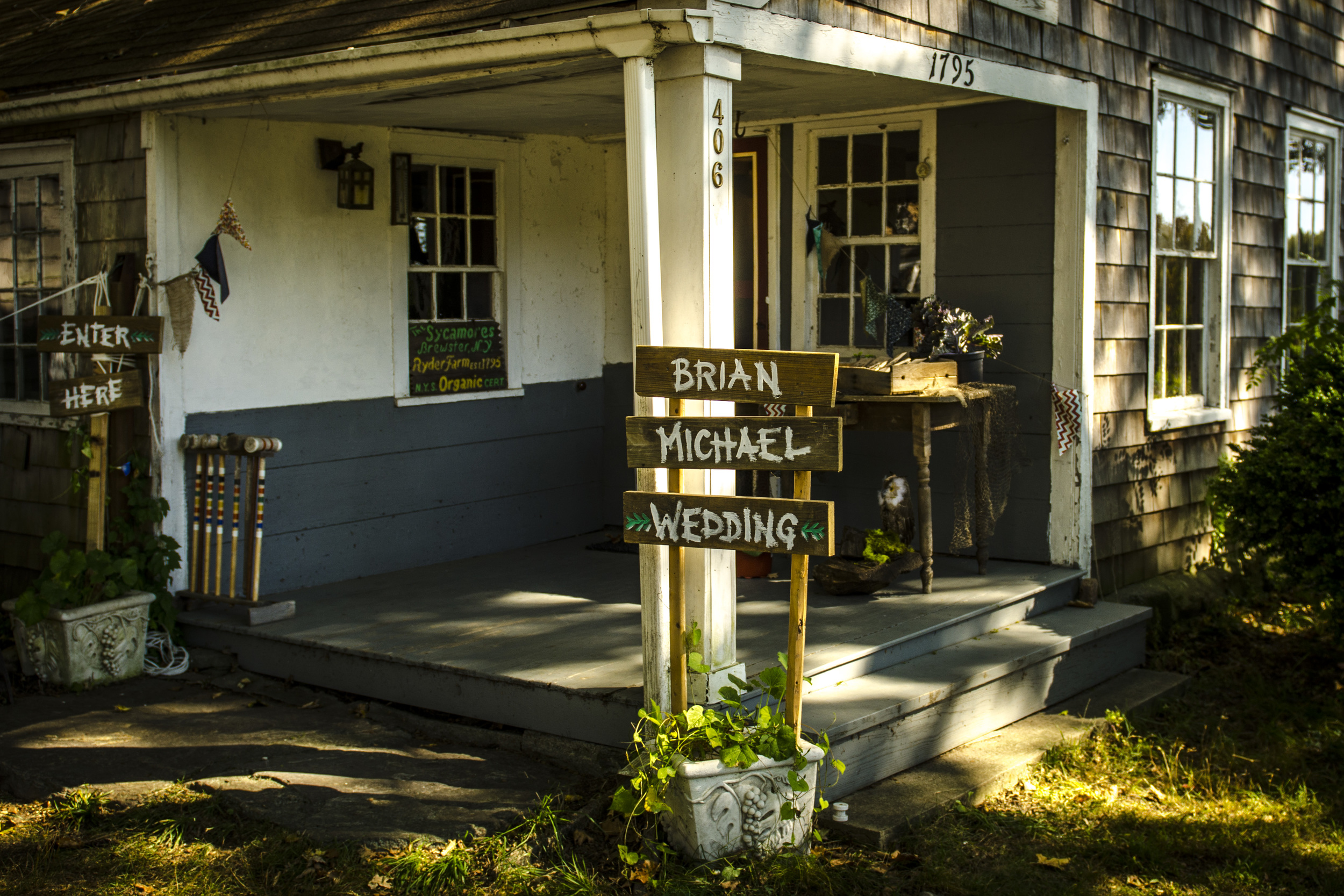 Rustic signs welcome guests to The Sycamores.