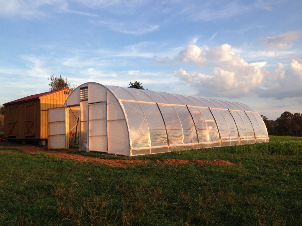 So new and clean: The walk-in fridge shed to left, and the greenhouse / wash-pack / office / shop / farm stand to right.