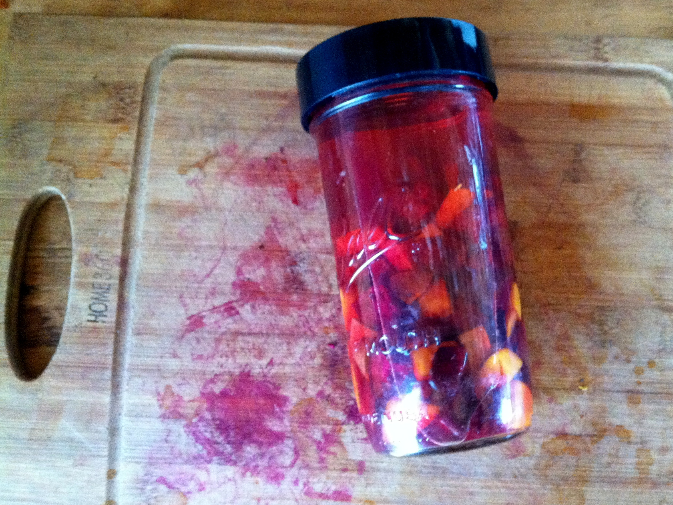 Fuzzy photo for a fizzy drink. This is the beet kvass just as the lid goes on -- red and gold beets, you might note. After a few days the beetiness saturates the liquid.