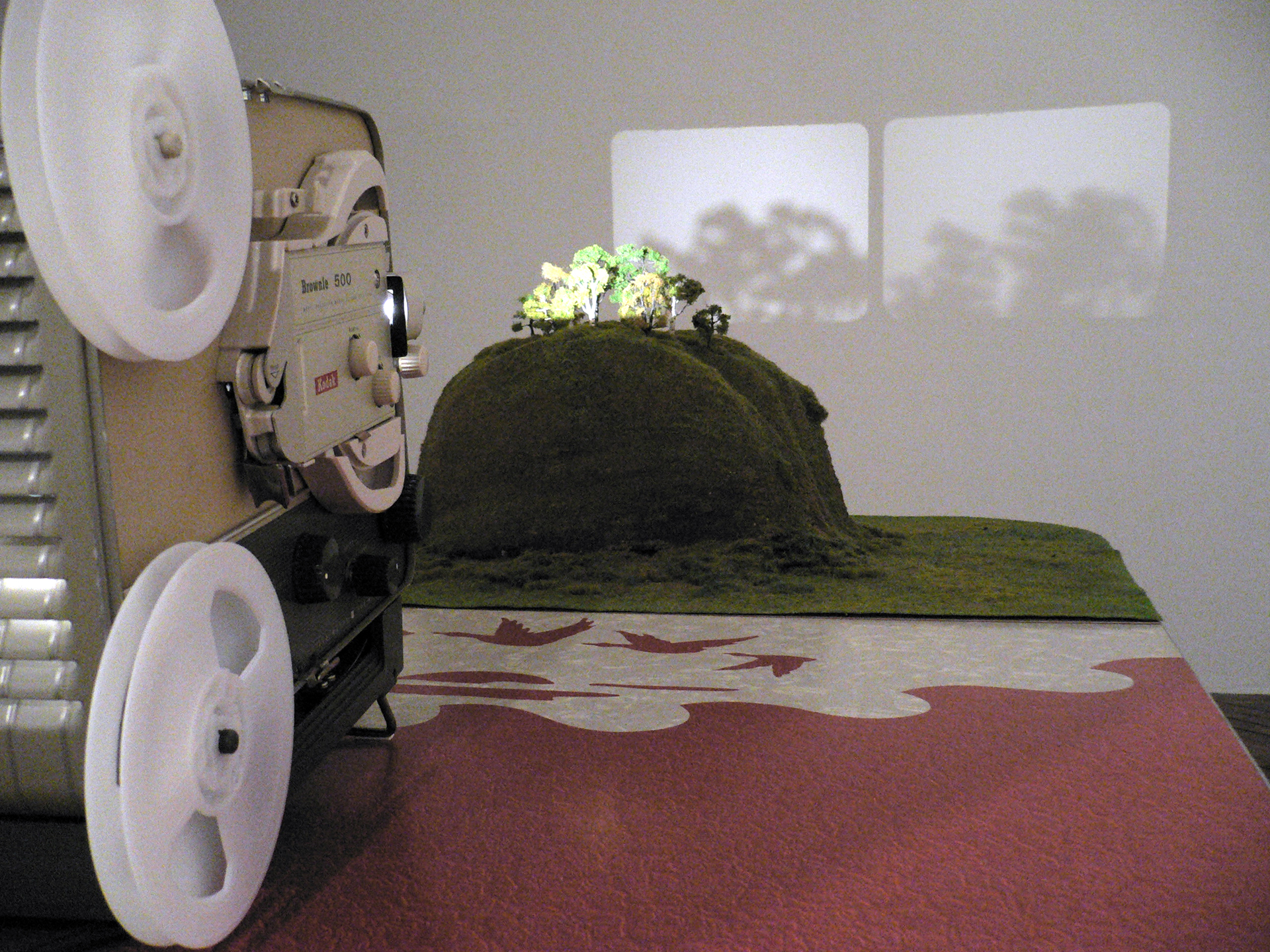 (detail shot of right projector, table and landscape)