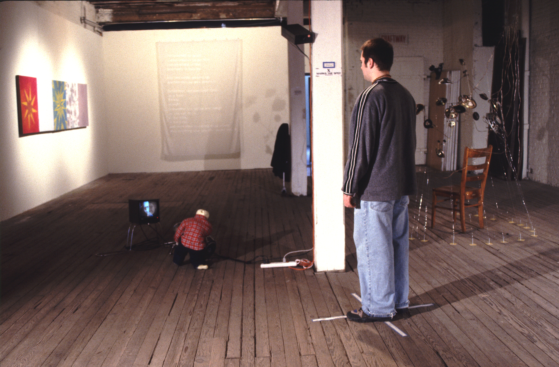 (installation view 1, populated))    Little Man, Big Grudge (X Marks the Spot)    1998   surveillance equipment, constructed light projection cannon, constructed figure   dimensions vary