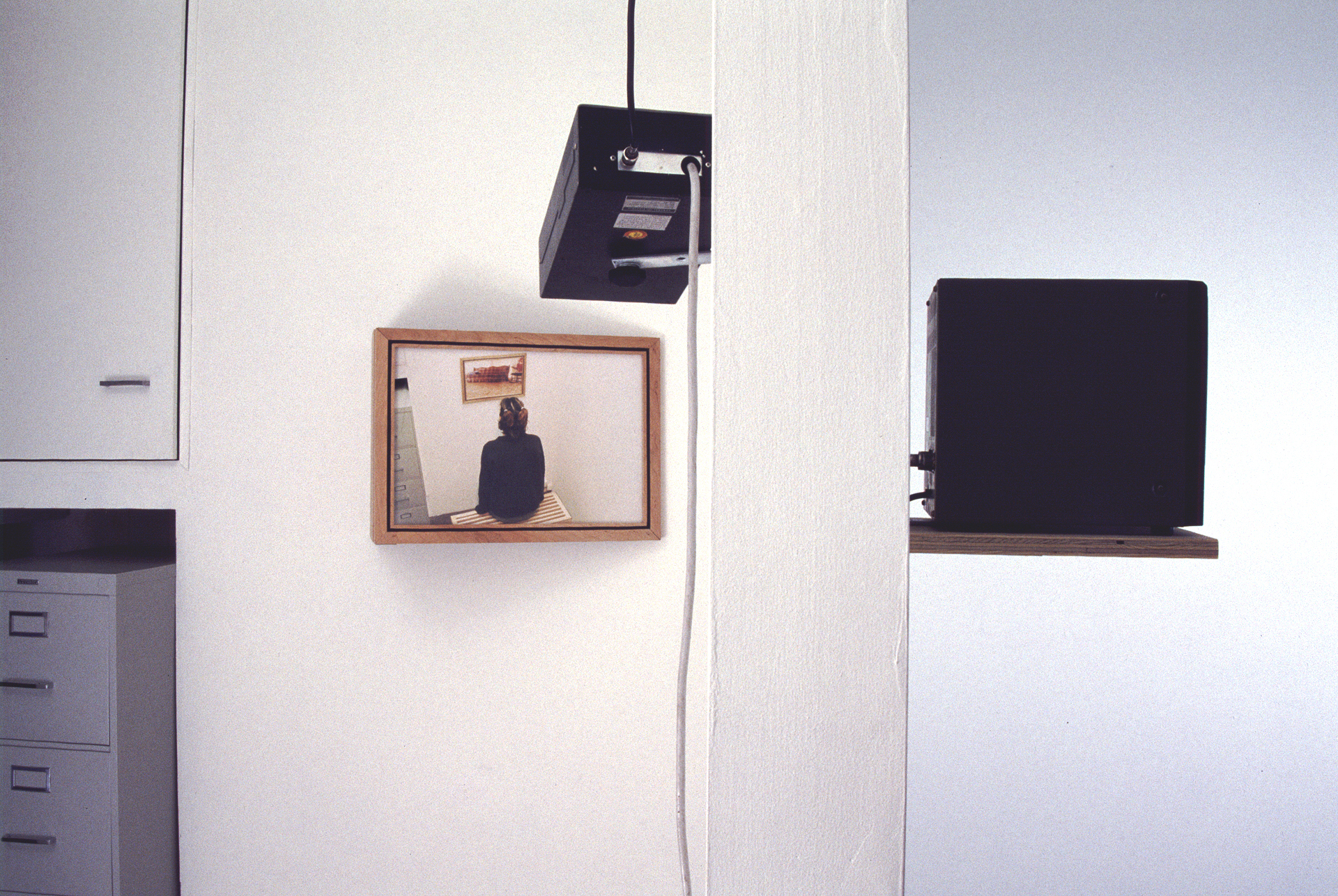 (installation view of the back room and the side of the patron wall simultaneously)