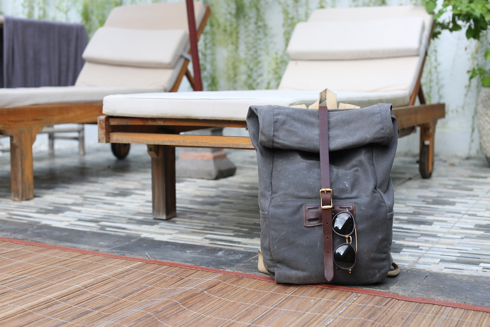 Carlos has an     Archival Roll top  rucksack  and prepared with his   Kapten and Son sunglasses